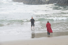my son getting water from the ocean for his mom 2