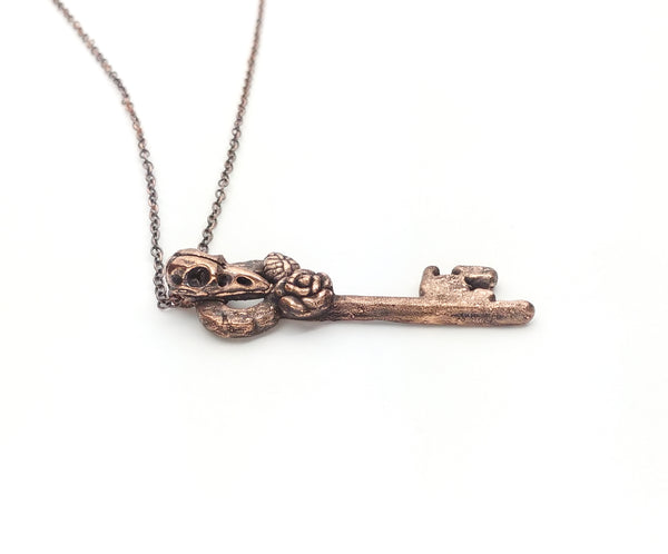 Raven Skull Carved Bone Copper Key Pendant