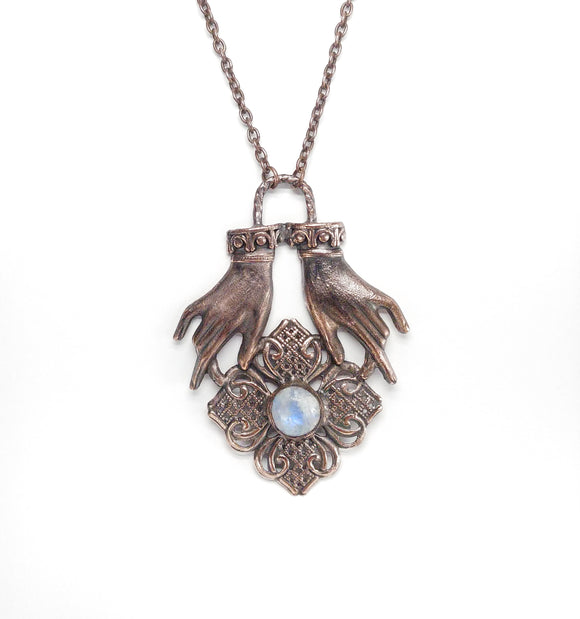 Hands Holding Flower w/ Rainbow Moonstone Pendant