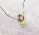 Bottle with Raw Peridot, Faceted Crystal Top and Peridot and crystal Beaded Chain