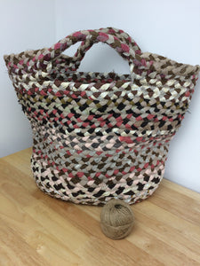 Large braided basket woodland hues