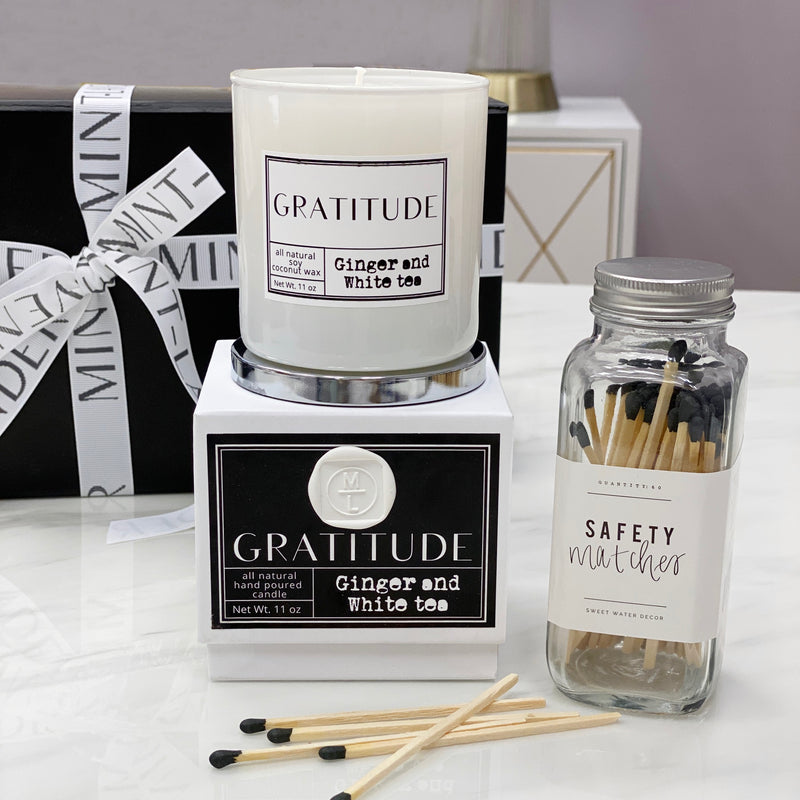 mint-lavender gratitude candle, black strike-on-bottle matches