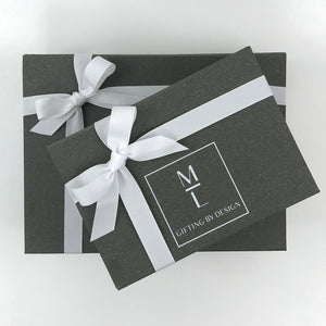 mint-lavender gray gift box with white ribbon