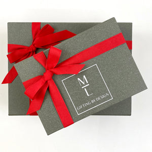 mint-lavender gray gift box with red ribbon