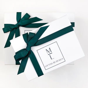 mint-lavender white gift box with green ribbon