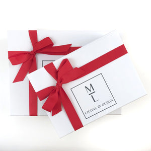 white mint-lavender gift box with red ribbon