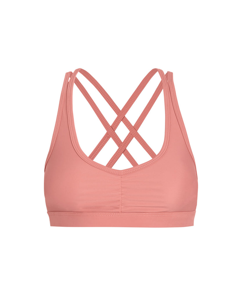 front of crossback sports bra in guava pink color