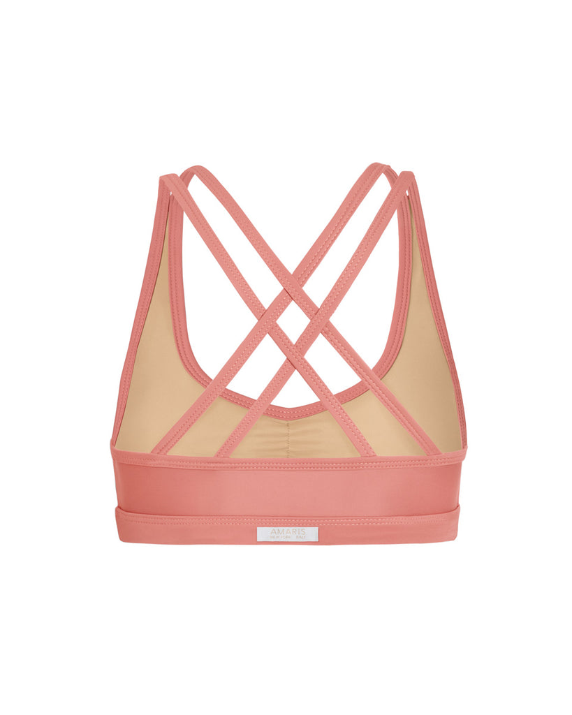 back of crossback sports bra in guava pink color