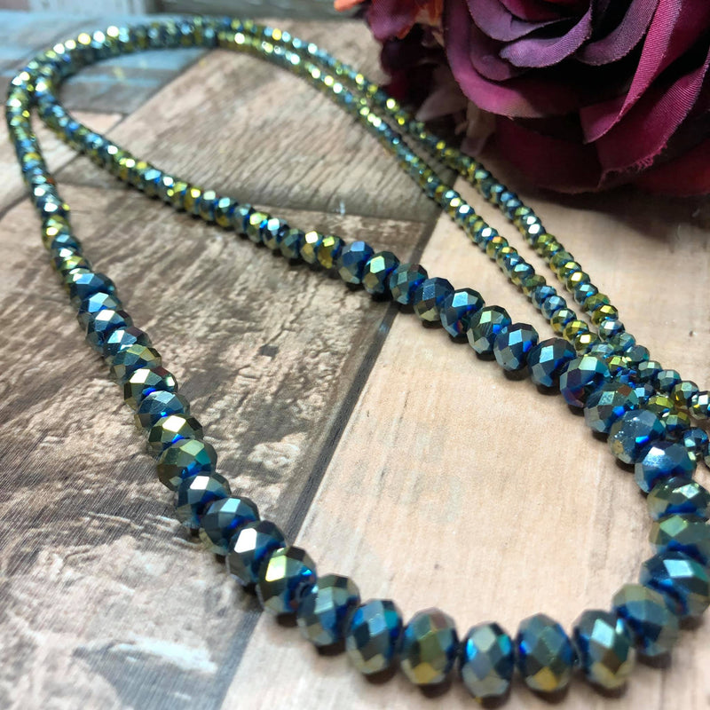Long beaded necklace - northern lights green
