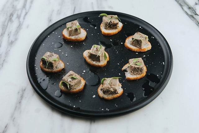 Marscapone Cream with smoked wild salmon, lemon juice and black pepper canapes