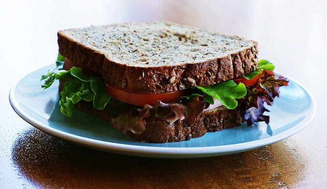 Italian tuna mayonnaise with sun blushed tomatoes fresh rocket and balsamic glaze Sandwich