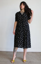 Load image into Gallery viewer, 1940s Black Rayon Crepe Button Print Dress