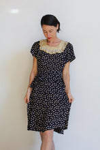 Load image into Gallery viewer, Early 1940s Navy Blue Polka Dot Silk Rayon Peplum Dress with Butterfly Lace Collar