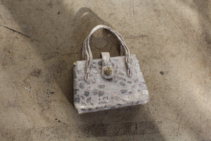 1960s Silver Brocade Strappy Handbag with Apple Rhinestone Snap Closure