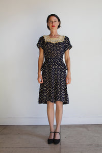 Early 1940s Navy Blue Polka Dot Silk Rayon Peplum Dress with Butterfly Lace Collar