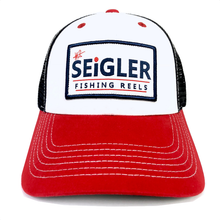 "Load image into Gallery viewer, SEiGLER Red White & Blue Trucker Cap  Our SEiGLER Six-panel trucker cap with White cotton front with a Red bill and Navy mesh back panels. Sewn SEiGLER Logo Patch on the front. Adjustable velcro  ""Old Glory"" Red"" back closure.  Black under the bill to reduce glare while on the water.   One size fits all"