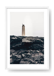 Lighthouse On Top Of Black Rocks