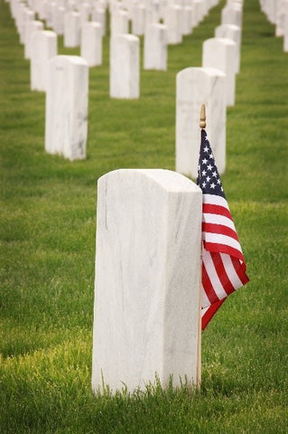 Harbor Caskets (American made caskets and coffins) - How to Plan a Funeral. Tombstone in cemetery with American flag.