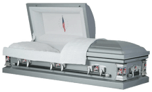 Load image into Gallery viewer, Harbor Caskets - The Harbor Military Steel. Casket in Silver - Comes in Rubber Gasket and 20-Gauge or 18-Gauge. Casket has a White Crepe Interior, Sculpted Hardware, and a Flag or Eagle Imagery available.
