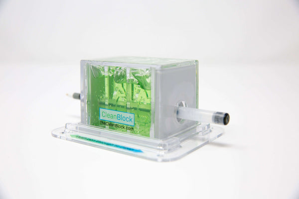 CleanBlock™ and Base Mount slanted view green white background pen cleaner sanitizer