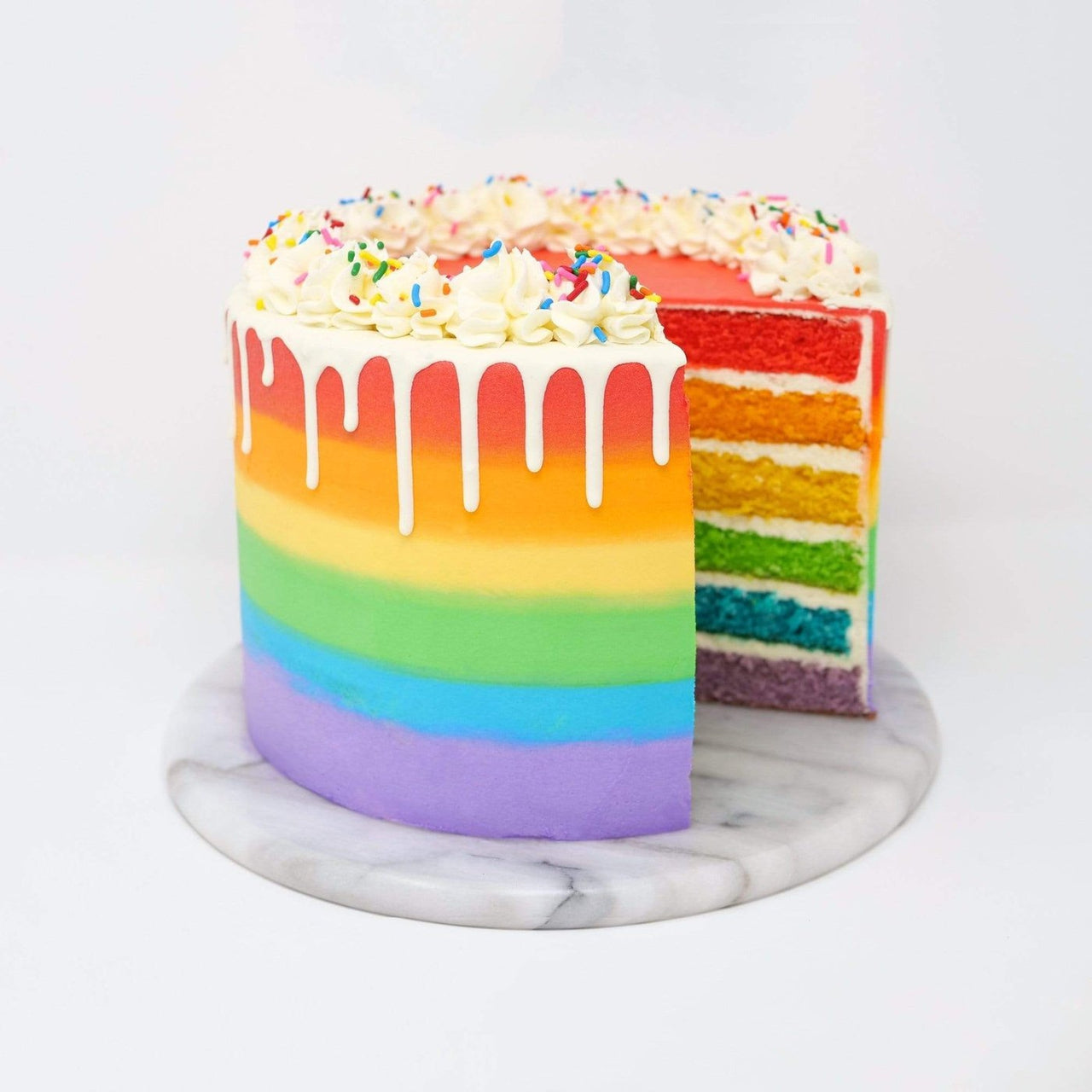 Double Rainbow Cake With White Chocolate Drip