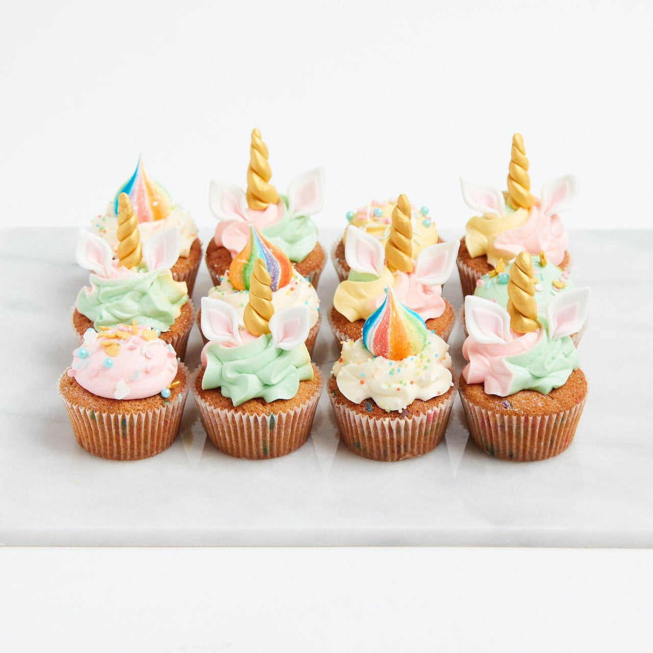 Full-On Unicorn Cupcakes by Crumbs & Doilies