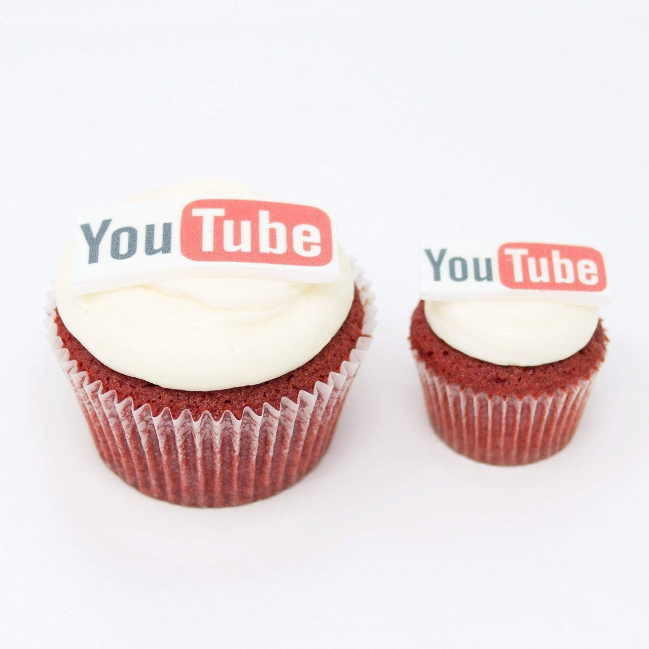 Red velvet cupcakes with printed edible logos