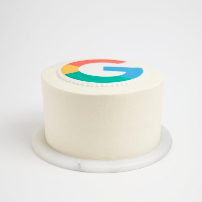 White iced cake with logo