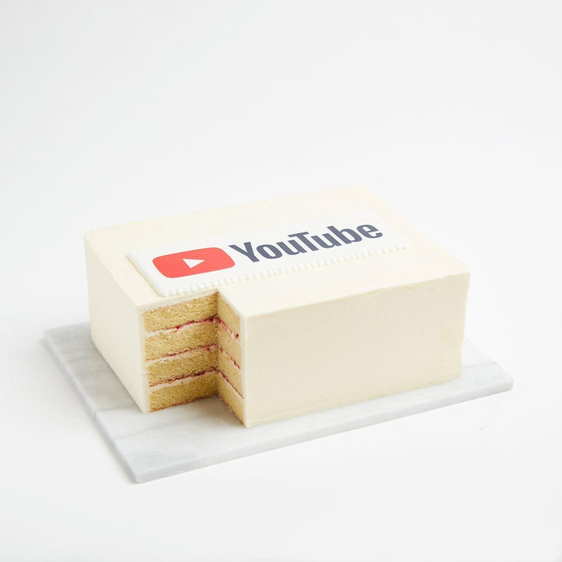 White iced sheet cake with logo