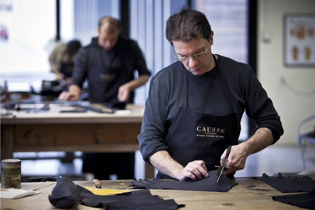 craftman cutting leather