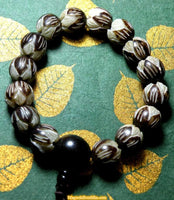 Wrist Mala in lotus carved seeds - Vegetable ivory