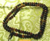 Small mala in amber color agate