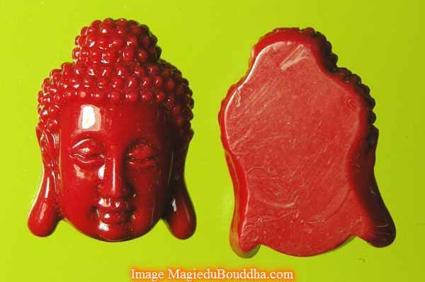 "Pearls ""buddha heads"" in coral-colored glass"