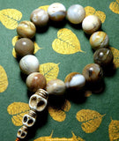 Tantric wrist mala made of fossil wood