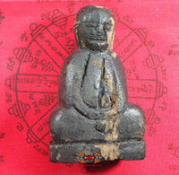 Wooden statue of the ancient and primitive Buddha