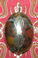 Kailash stone pendant with copper dorje