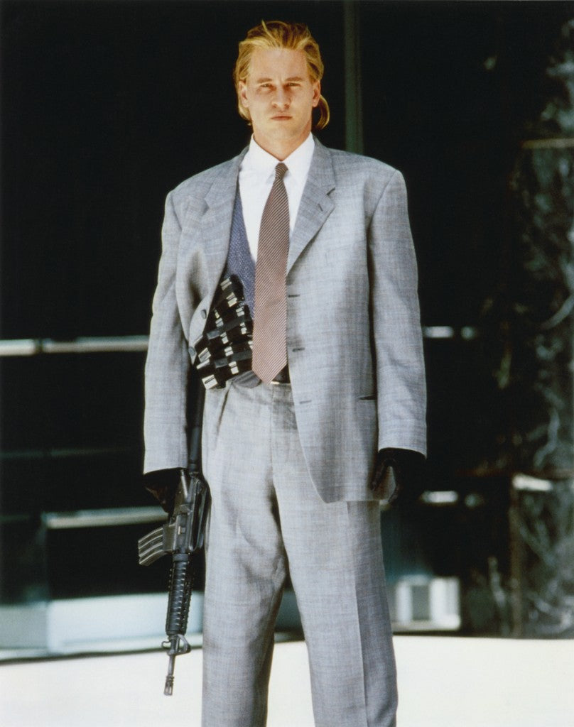 val_posing_in_suit_and_holding_machine_gun_heat