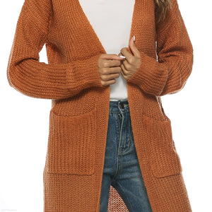 A Long Knitted Cardigan In A Large Pocket