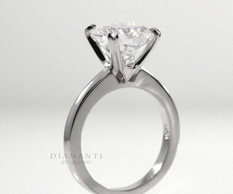 double claw prong solitaire Cartier style ring