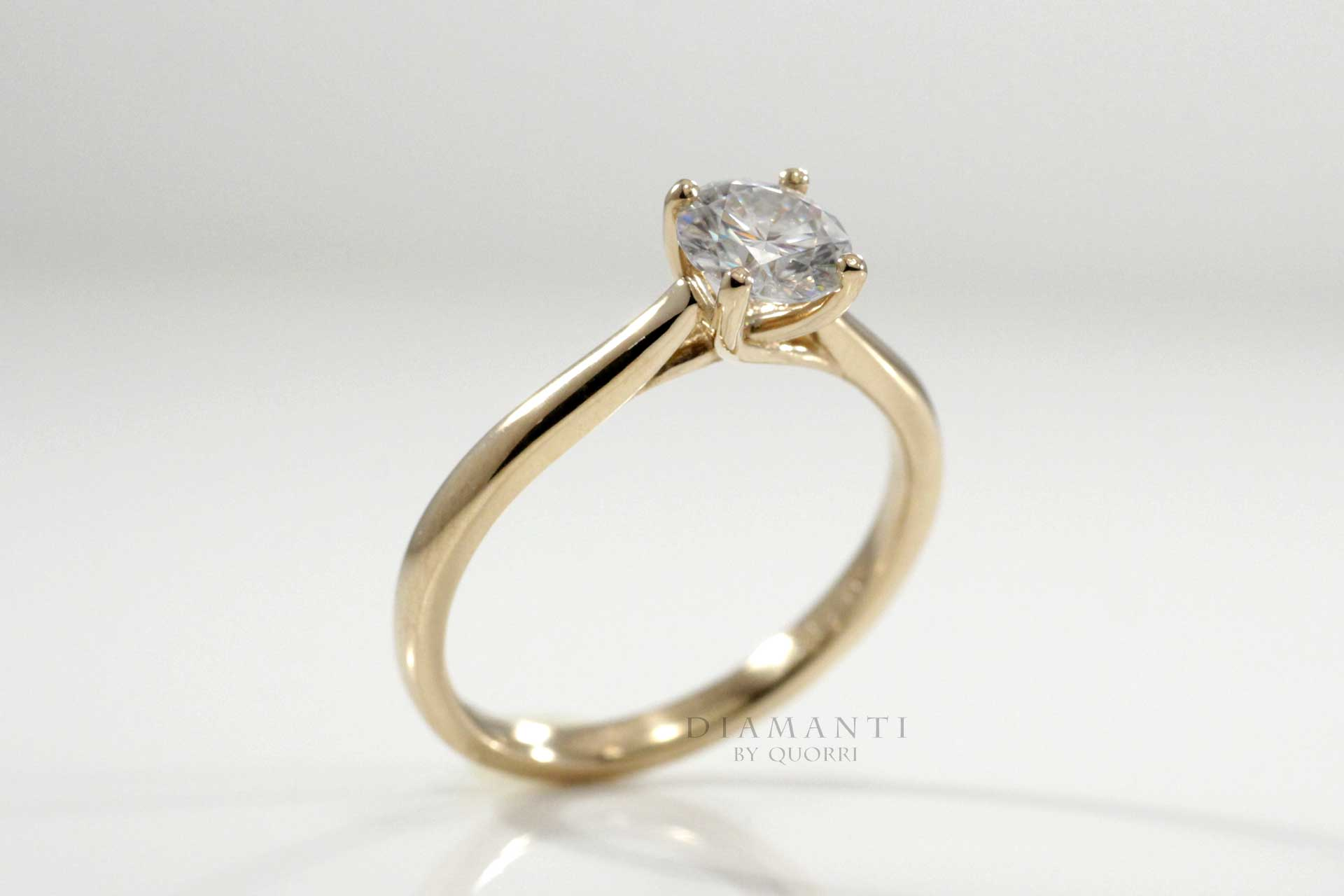 petite diamond solitaire ring in yellow gold made in canada