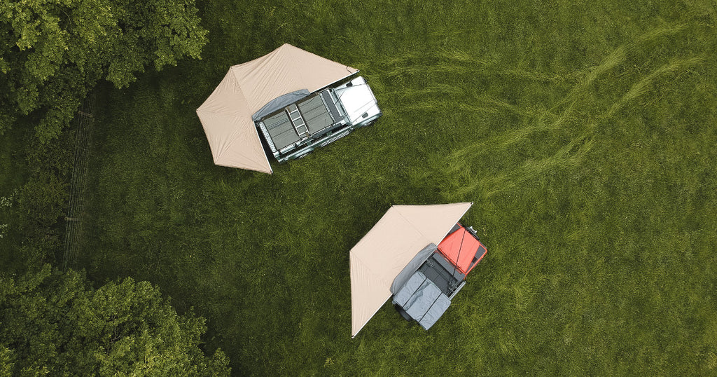 Direct4x4 overland expedition gear top down view of 2 Land Rover Defenders with side awnings