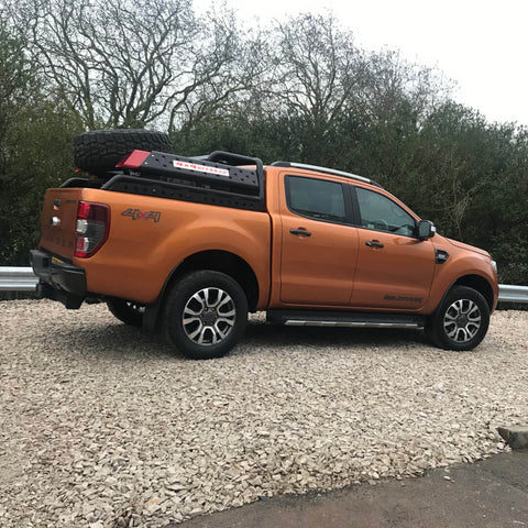Direct4x4 super chunky 4x4 roll sports bar and spare wheel carrier on an orange Ford Ranger.