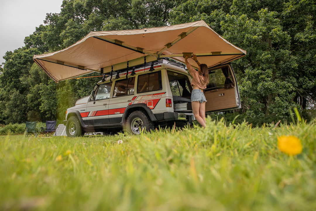 Direct4x4 expedition vehicle side awning on a classic Mitsubishi Pajero 4x4