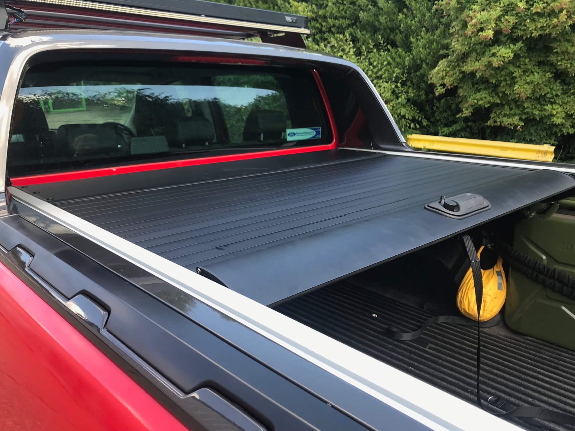 Direct4x4 pickup truck roll and lock style load bed tonneau cover on a red Ford Ranger Wildtrak