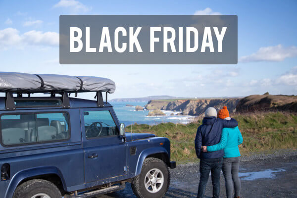 Direct4x4 Black Friday landing page link with a blue Land Rover Defender and a couple in front of the beach