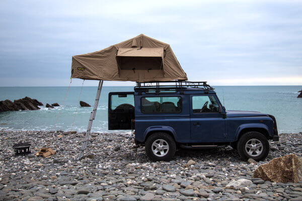 Direct4x4 overland expedition camping roof top tent on a Land Rover Defender 90
