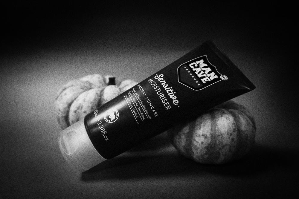 A ManCave Sensitive Moisturiser with small pumpkins in black and white