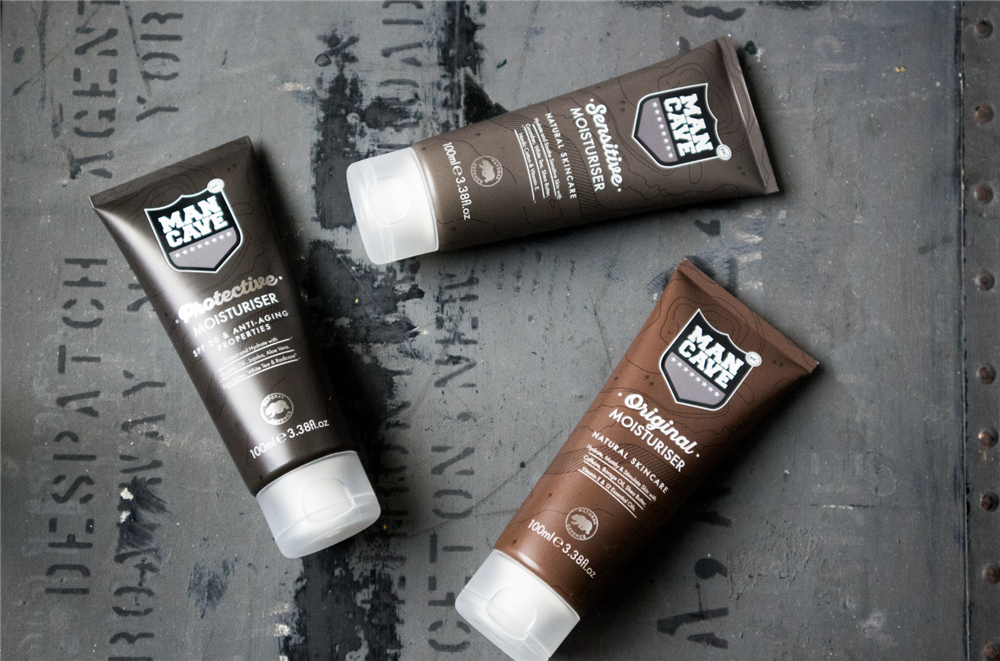A selection of three ManCave products: (from left to right) Protective Moisturiser, Sensitive Moisturiser and Original Moisturiser on a grey background
