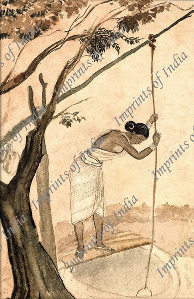 Indian village woman drawing water from the well