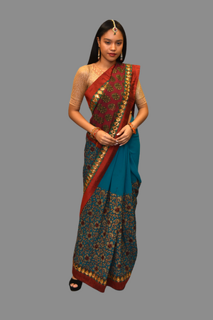 Silk Georgette Embroidered Teal Blue With Contrast Cranberry Red Border Saree